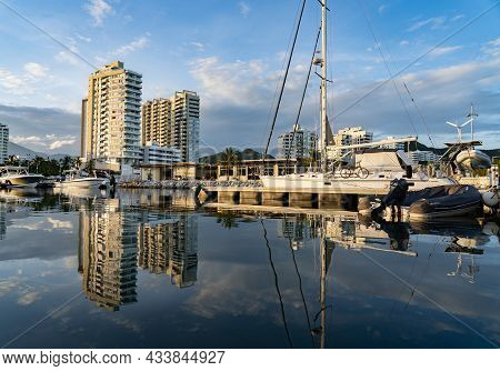 Panoramic View Of Luxury Marina With Sailboat On The Dock During Sunset