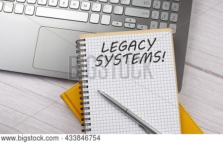 Legacy System Text Written On Notebook On The Laptop