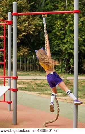 Sporty Little Girl Workout Outdoor On Sports Ground. Schoolgirl Preteen Wearing Fashionable Sportswe