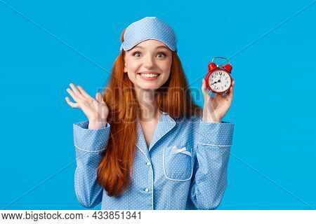Cheerful And Enthusiastic Redhead Girl Dont Want To Oversleep, Set Alarm Clock, Holding Red Watch An