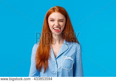 Sassy And Excited Good-looking Redhead Female In Nightwear, Winking Joyfully And Smiling Camera, Fee
