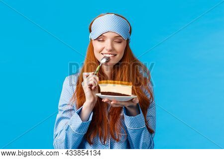 Girl Feeling Satisfaction Eating Sweet Delicious Dessert In Morning. Attractive Cute Woman With Red