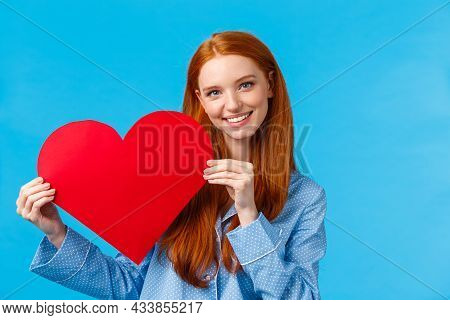 Tenderness, Care And Romance Concept. Romantic Good-looking Redhead Female In Nightwear Giving Her A