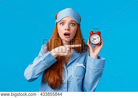 Shocked And Concerned, Worried Cute Redhead Girl Pointing At Alarm Clock With Frustrated, Nervous Ex