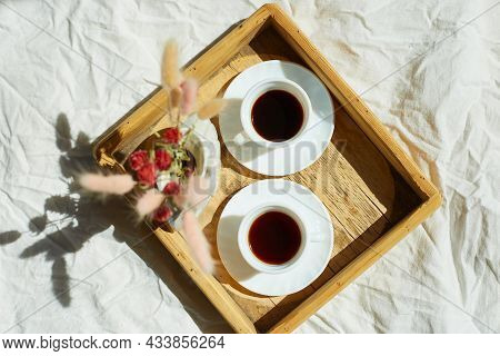 Breakfast In Bed, Try With Two Cups Coffee And Flower In Sunlight At Home