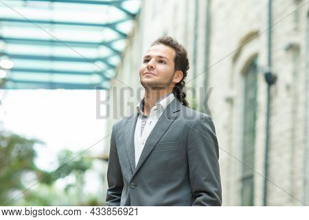 A Young Successful Businessman Is Working Outdoor Using Smartphone. Man In A Casual Wear. Business,