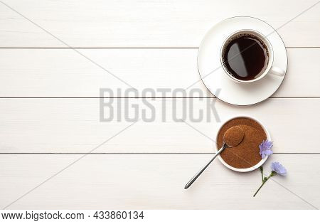 Cup Of Delicious Chicory Drink, Powder And Flowers On White Wooden Table, Flat Lay. Space For Text