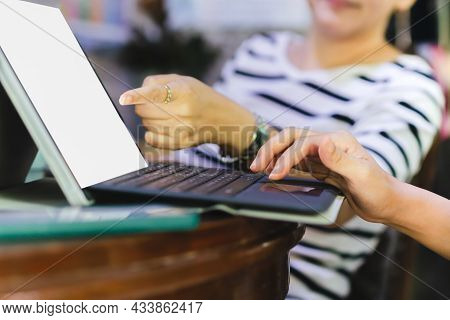 Businesswomen Teamwork Sitting By Desk Using Computer Laptop Discussing In Office.