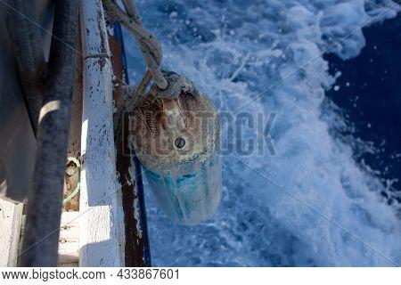 Old Boat Fender Bumper Against Sea Water Splashes. Moving Yacht. Marmaris, Turkey - September 8, 202