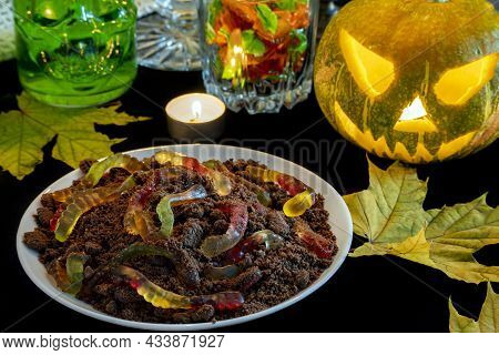 Desert Is A Theme For Halloween Holiday In Form Of Land With Marmalade Worms On Decorated Party Tabl