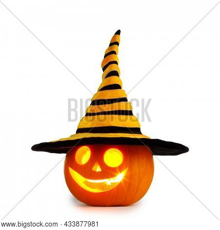 Jack O Lantern Halloween funny pumpkin with carved smiling face with witches hat isolated on white background