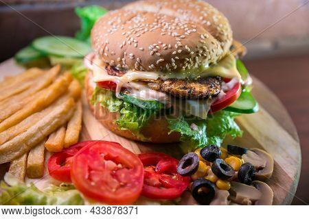 Fresh And Tasty Hamburger With Tomato And Green Leaves Big Size Hamburger Fast Food Snacks Onion Gri