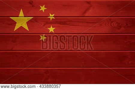 China Flag On An Old Wooden Surface. Old Wood Texture. National Day Of The People's Republic Of Chin