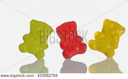 Dancing Colorful Jelly Gummy Bears, Isolated On White Background. Multicolored Jelly Bears Candy Iso