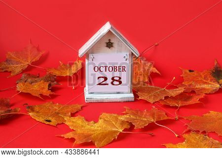 Calendar For October 28 : Decorative House With The Name Of The Month In English, The Number 28, Aut