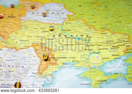 National Flag Ukraine Pinned On Political Europe Map. Macro Close Up Picture On A Colorful And Blurr