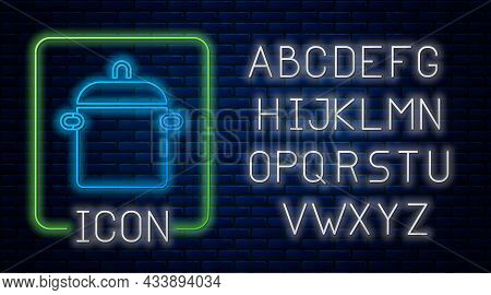 Glowing Neon Cooking Pot Icon Isolated On Brick Wall Background. Boil Or Stew Food Symbol. Neon Ligh