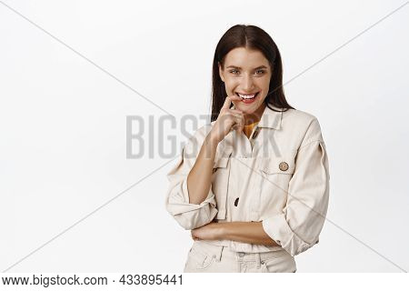 Sassy Brunette Woman, Smiling Flirty, Biting Finger And Smiling Cunning, Has Something In Mind, Thin
