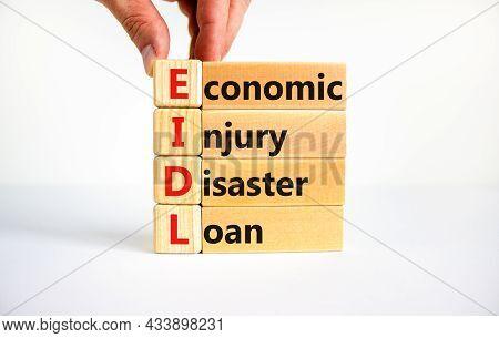 Eidl Symbol. Abbreviation Eidl Economic Injury Disaster Loan On Wooden Blocks. Beautiful White Backg