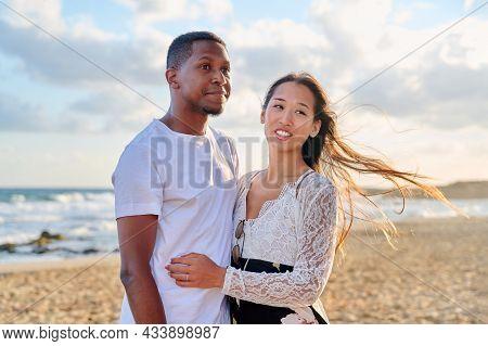 Loving Romantic Hugging Young Multiethnic Couple On The Seashore