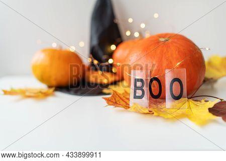Autumn Leaves With Pumpkin Border At The Bottom, Black Hat, Beautiful Autumn Background. Flashing Li