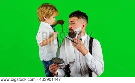 Barbershop Advertising. Son And Father In Barbershop. Assistant For Dad. Fathers Day. Shaving In Bar