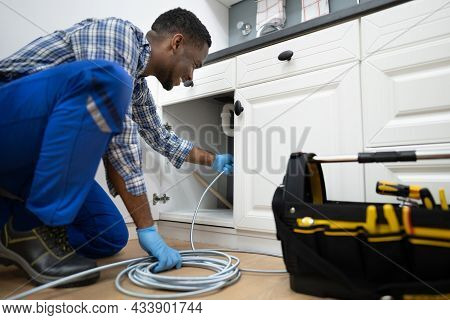Plumber Drain Cleaning Services In Kitchen. Unclog Blocked Pipe