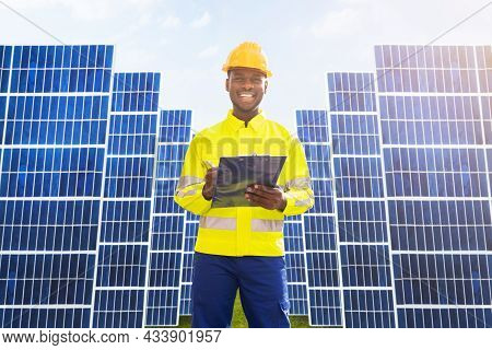 Photovoltaic Green Energy Technology. Worker At Solar Panel Plant