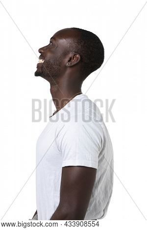African boy in profile smile on a white background looks up. Copy space