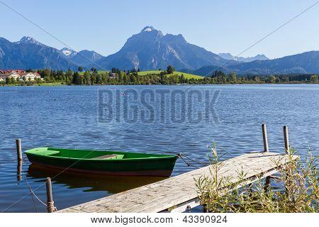 Alps Panorama With Lake, Runway And Boat