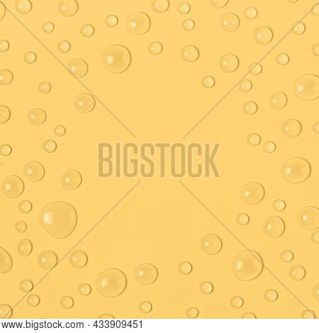 Frame Of Water Drops On A Pastel Yellow Background. Water Texture Close Up. Backdrop Glass Covered W