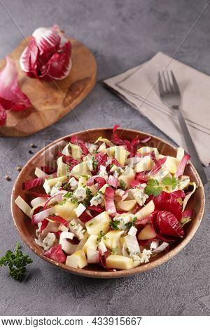 chicory salad with apple,  cheese and walnut
