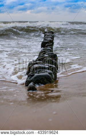 Breakwater On The Beach Of The Polish Baltic Sea Near Rewal