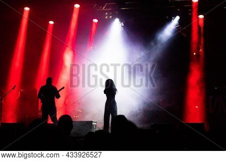 singer silhouette on stage concert at music festival