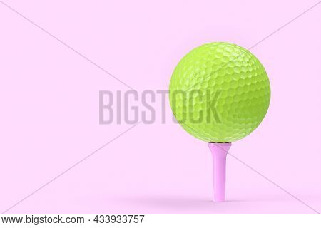 Green Golf Ball On Tee Isolated On Pink Background