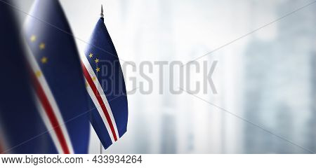 Small Flags Of Cape Verde On A Blurry Background Of The City