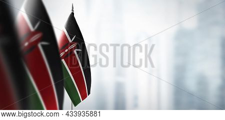 Small Flags Of Kenya On A Blurry Background Of The City