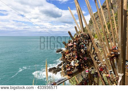 Riomaggiore, Cinque Terre - Italy, May 12, 2019: Love Locks On The Gate To Azure Path (path Of Love)