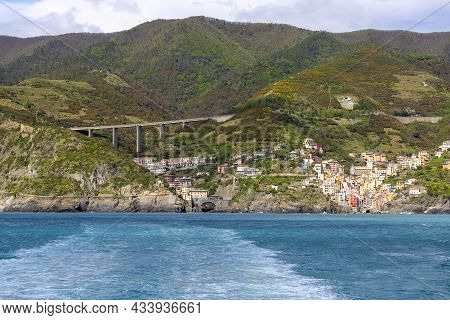 View Of The Mediterranean Coast, Turquoise Water And Surrounding Rocks, With Railway Viaduct, Riomag