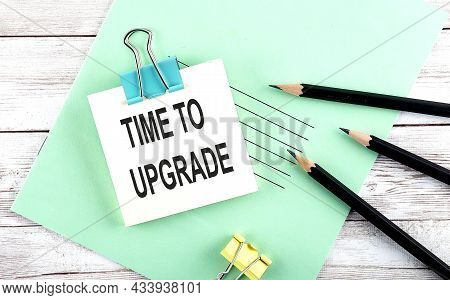 Text Time To Upgrade On The Short Note With Pencils On The Wooden Background