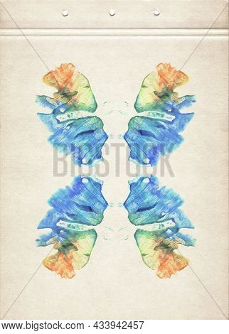 A Sheet Of Brown Vintage Aged Paper Stained With Symmetric Blue, Orange, Green And Yellow Watercolor