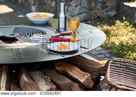 Kettle Grill Pit With Cast Iron Grid With Flames . Round Table-cooking Surface. Hot Bbq On Backyard