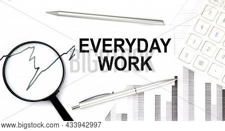 Everyday Work Text On The Document With Pen,graph And Magnifier,calculator