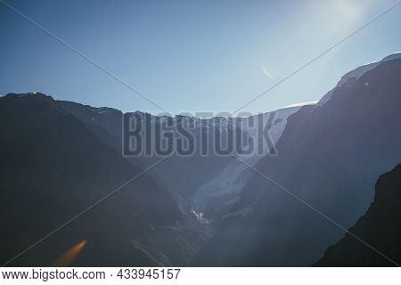 Colorful View To High Silhouettes Of Snowy Mountains And Glacier In Sunlight. Beautiful Sunny Scener