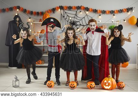 Portrait Of Creative Little Boys And Girls Who Scare During Halloween Party At Home.