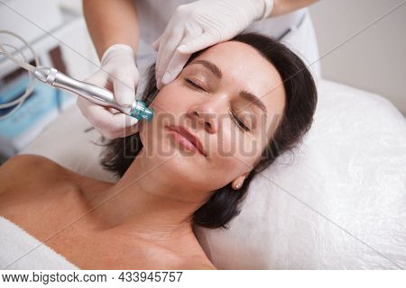 Close Up Of A Mature Woman Getting Hydra Skincare Facial Cleanse At Beauty Salon