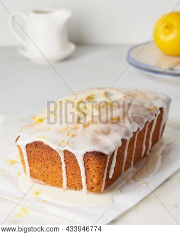 Lemon Bread With Poppy Seeds, Citrus Zest And Frosting On Top. Home Made Fruit Bakery Pouring With W