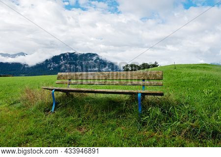 A Calm Place To Rest And Relax. An Empty Wooden Bench. Switzerland