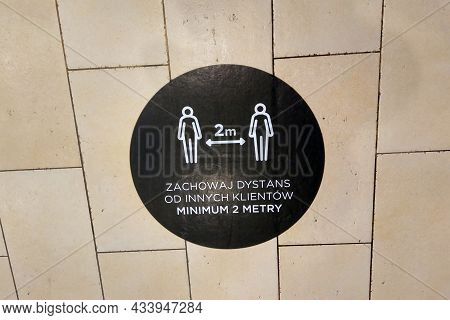 On A Tile In A Shopping Center, There Is A Warning About Maintaining A Distance Of Two Meters Due To
