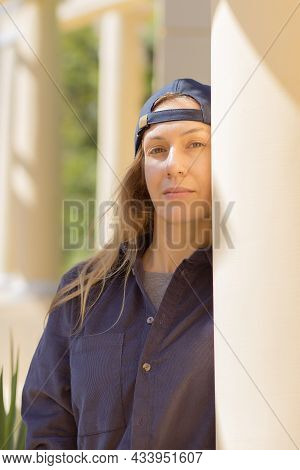 Hiphop Lady Stands Leaning Against A Column In The Park On A Sunny Summer Day.